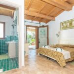 bed-and-breakfast-villa-flumini-camera-verde-camera-da-letto-matrimoniale-e-bagno