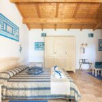 bed-and-breakfast-villa-flumini-camera-blu-letto-matrimoniale